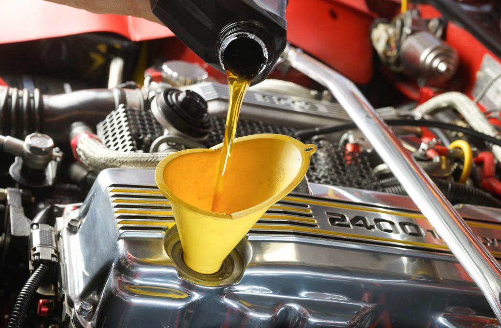 synthetic oil being poured into engine