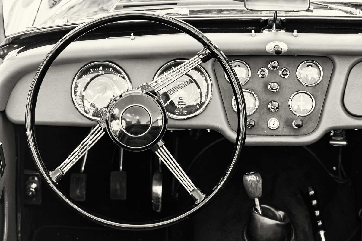 steering wheel and dashboard of an old car